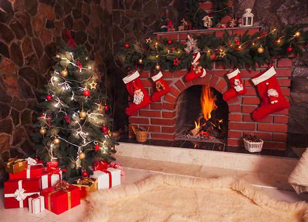 fireplace with christmas gifts stockings and decorations