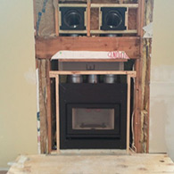 Partial installation of a High efficiency wood burning fireplace