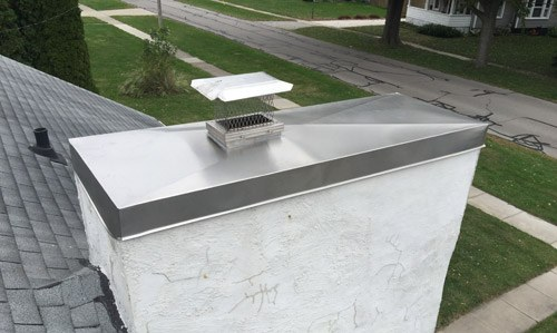 Side view with new chimney cap