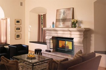 Wood fireplace adds warmth.  Design by Valcourt.