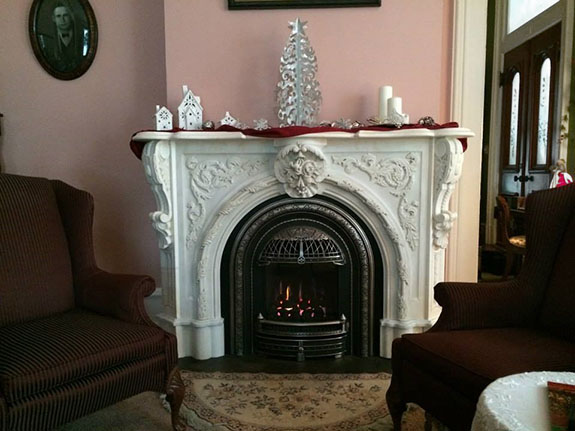 mantel decorated in modern style with silver and red theme