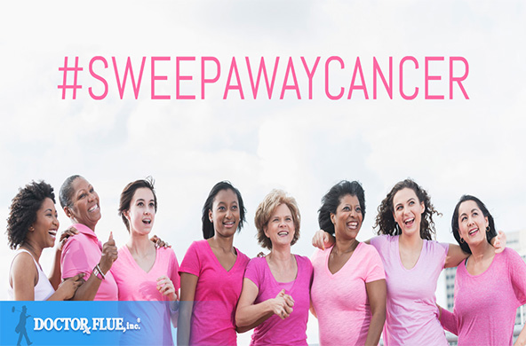 Group of women wearing pink t-shirts. Text above reads #sweep away cancer.