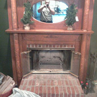 Before picture of a wood burning fireplace with some unnecessary safety risks