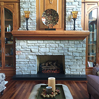 High-volume burner and gas log. Sold and installed by Doctor Flue, Inc.