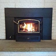 Regency 1200 wood burning insert installed by Doctor Flue inc.